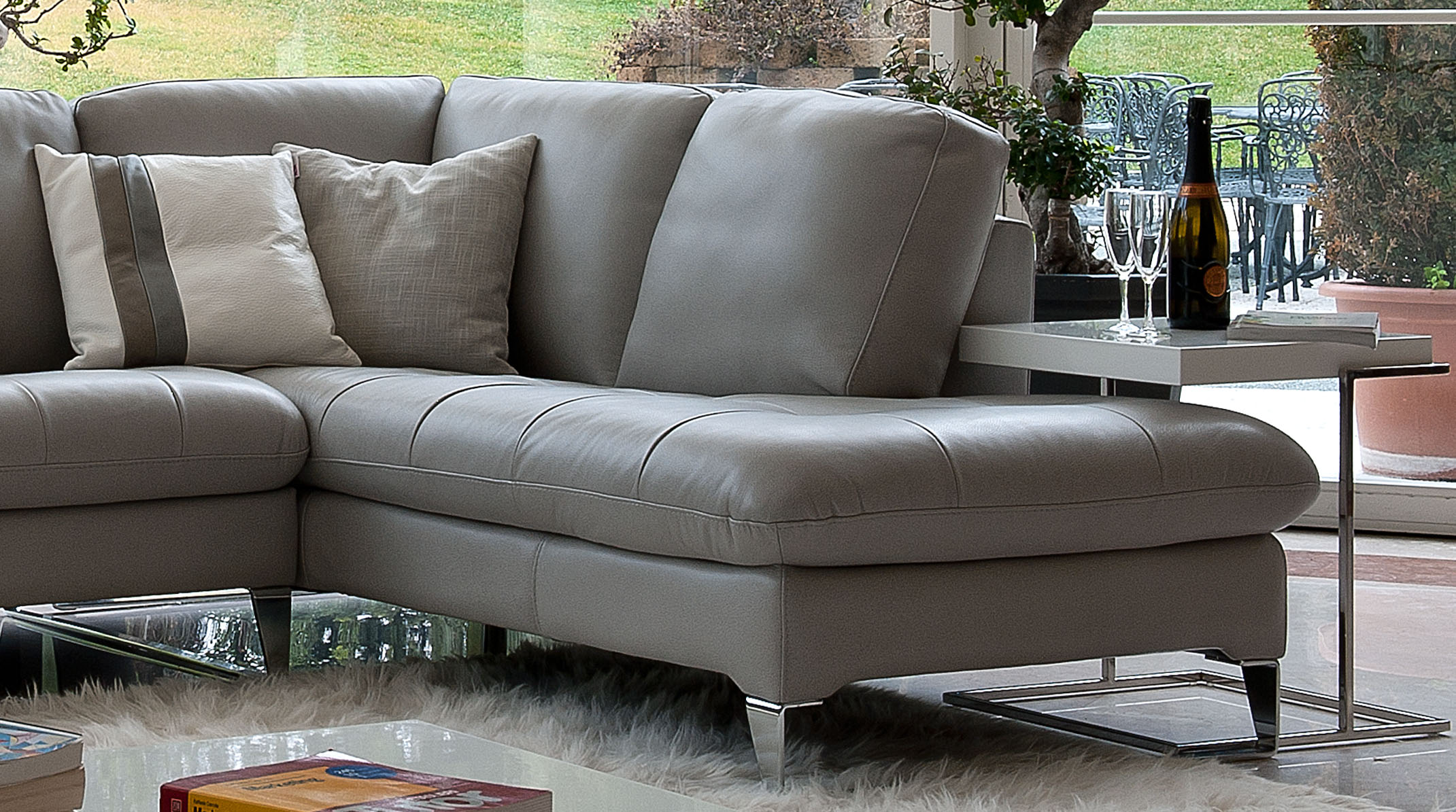 Refined Covered In All Leather Sectional Larger Image