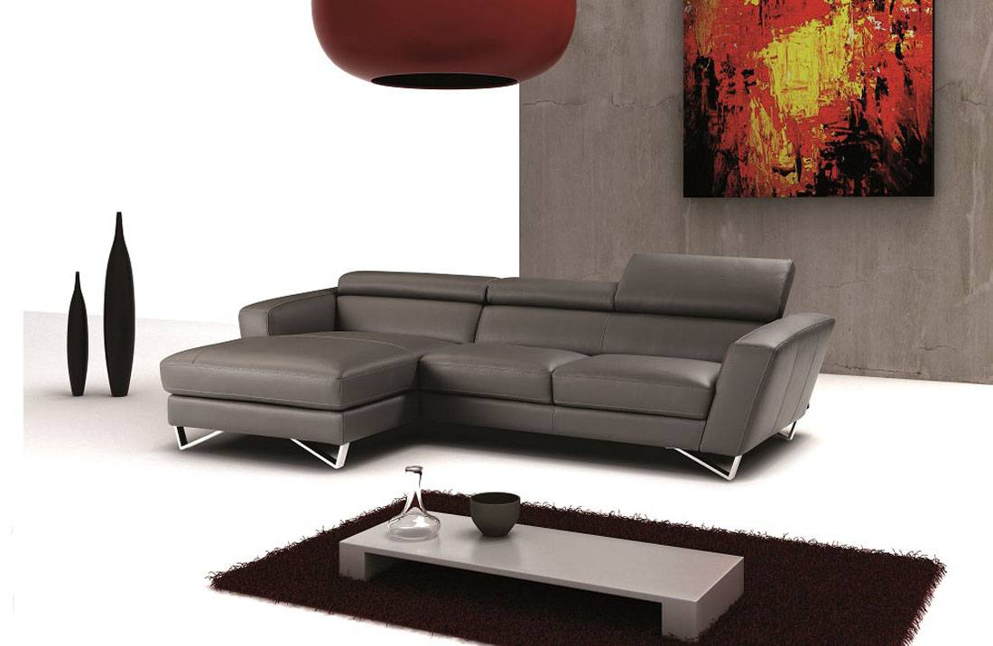 leather sectional in cream color with builtin coffee table p