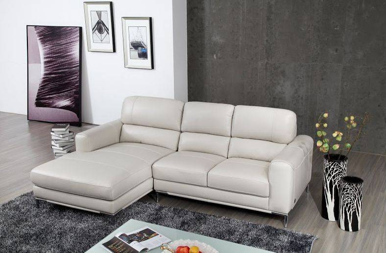 bone colored top grain leather sectional sofa with chrome