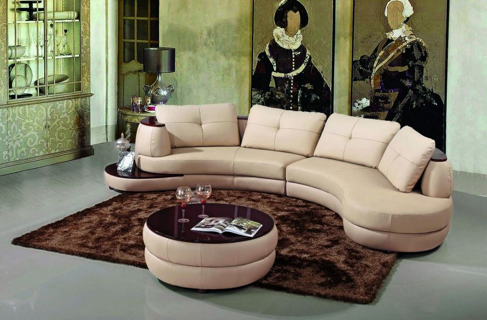 ivory bonded leather sectional sofa with a coffee table